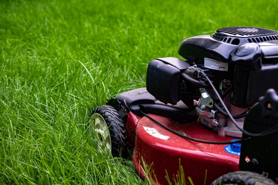 A motorcycle parked in a grassy field  Description automatically generated